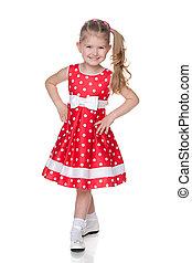 Little girl in the polka dot dress