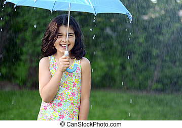 little girl in the rain with blue umbrella
