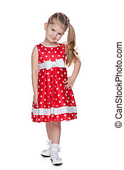 Little girl in the red polka dot dress