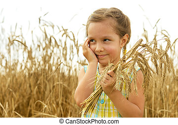 Little girl in the wheat field