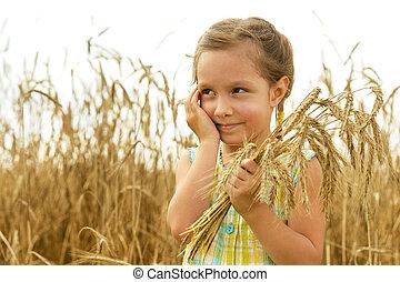 Little girl in the wheat field