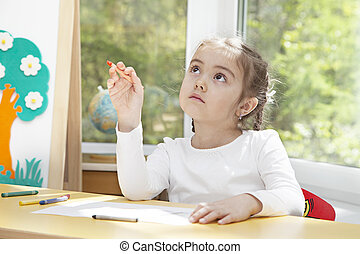 Little girl in thoughts of her next picture