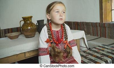 little girl in Ukrainian national costume - a little girl in...