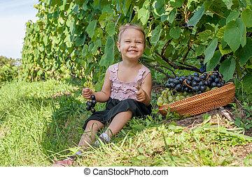 Little girl in vineyard