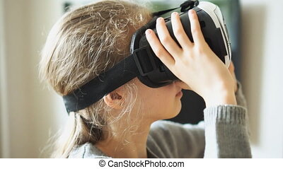 Little girl in VR headset at home.