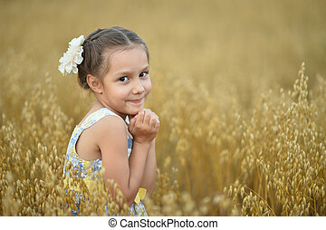 Little  girl in wheat field