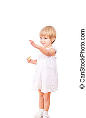 Little girl in white dress with bagel