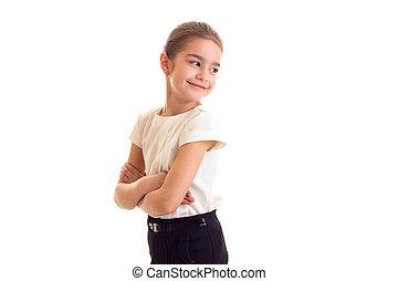 Little girl in white T-shirt and black skirt