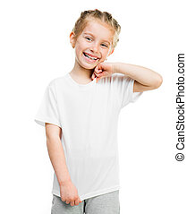 Cute little girl in tshirt isolated on a white background, studio shoot