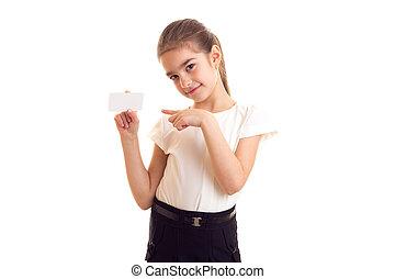 Little girl in white T-shirt holding white card