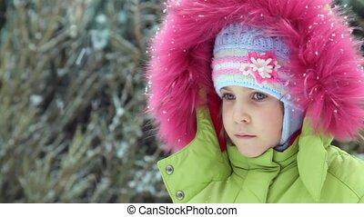 little girl in winter under snow