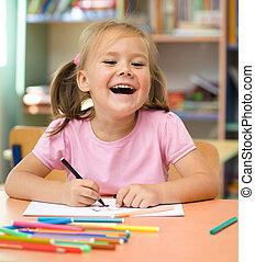 Little girl is drawing with felt-tip pen - Cute little girl...