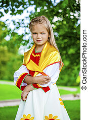 Little girl is dressed in the Russian national dress in ...