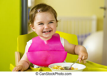 Little girl is eating
