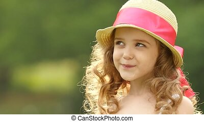 Little girl is embarrassed, she is very beautiful. Slow...
