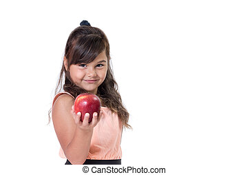 Little girl is holding a red apple in her hand