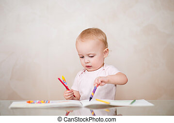 little girl is ineptly drawing a line with a pencil in a sketchbook