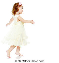 Little girl is jumping.