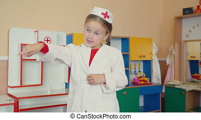 little girl is playing doctor - a little girl is playing in...