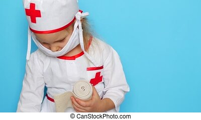 Little girl is playing doctor.