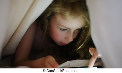 Little girl is playing game. - Little girl is playing game...
