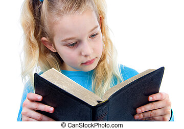 little girl is reading the Bible - little blonde girl is ...