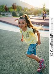 little girl is running in the park