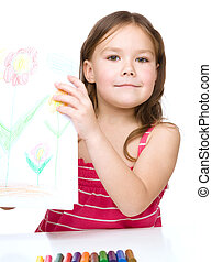 Little girl is showing her drawing