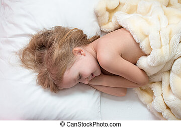 little girl is sleeping in a baby crib