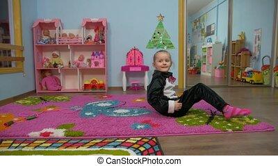 Little Girl Is Stretching - Little caucasian white european...