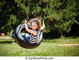 Little girl is swinging