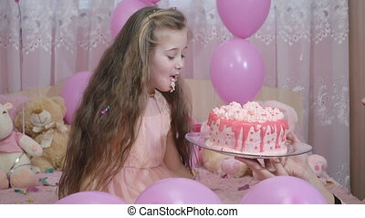 little girl is trying a cake