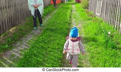 Little girl is walking with her grandmother