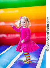 Little girl jumping and bouncing - Cute funny preschool...