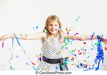 Little girl jumping and having fun celebrating birthday.