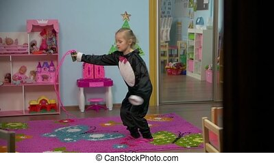 Little Girl Jumping With Skipping Rope - Little caucasian...