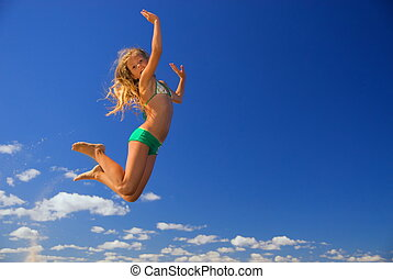 Little girl jumps in the sky