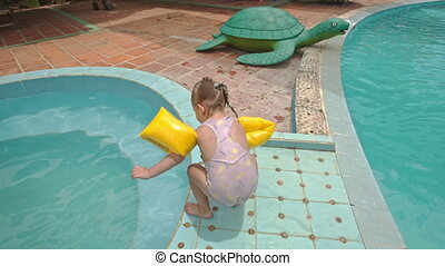 Little Girl Jumps into Pool by Toy Crocodile at Hotel