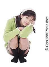 Little girl kneeling down, resting