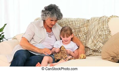 Little girl knitting with her grand