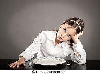 little girl lack of appetite - little girl sitting at table ...