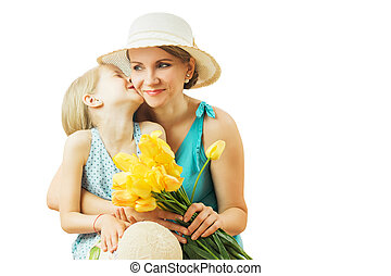 Little girl laughing merrily hugging her mom isolated on a white background.