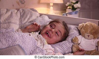 Little girl laughs before sleep - Little girl laughs while...