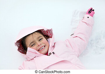 Little girl laying in the snow