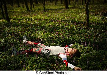 Little girl laying on green ground - Asian little girl...