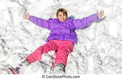 Little girl laying on the snow