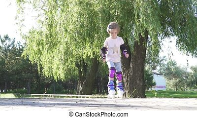 little girl learn to roller skate