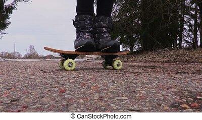 Little girl Learning to skateboard baby level step
