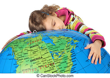 little girl lies on big inflatable globe and embracing it, ...