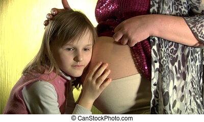little girl listen abdomen